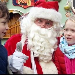 Kerstman met Kerstdraaiorgel .
